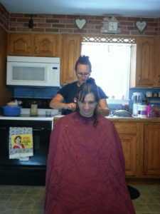 Mell cutting my hair for Chemo