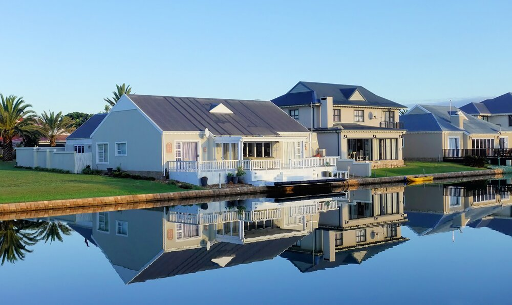 white-single-story-houses-beside-body-of-water-1438832