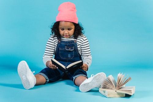 child reading book - dyslexia