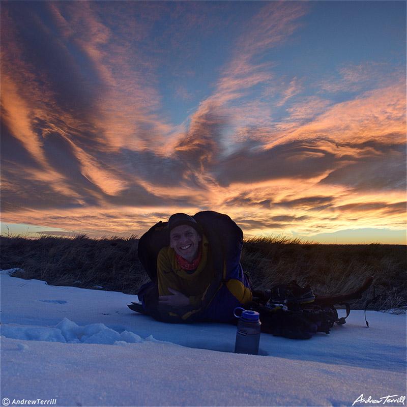cowboy camping bivvy on snow at sunrise andrew terrill