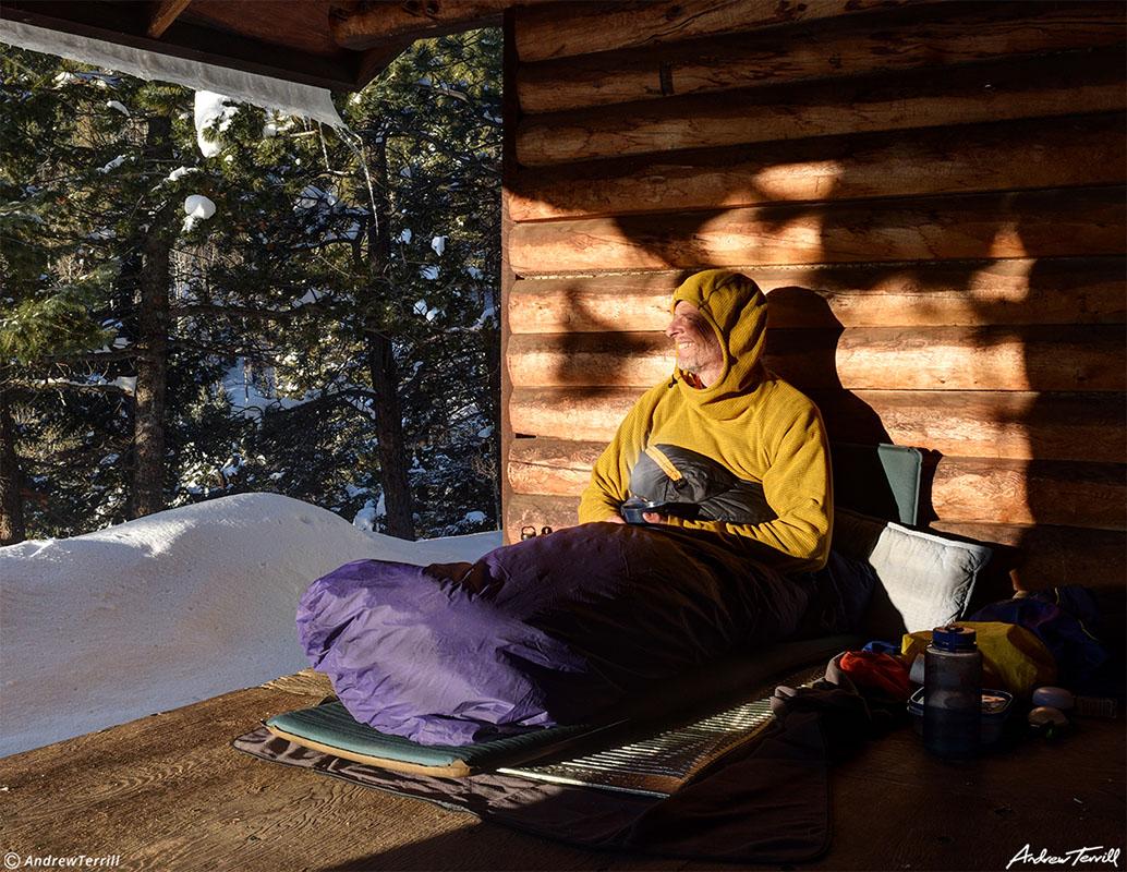 andrew terrill hiking enjoying morning sun in shelter