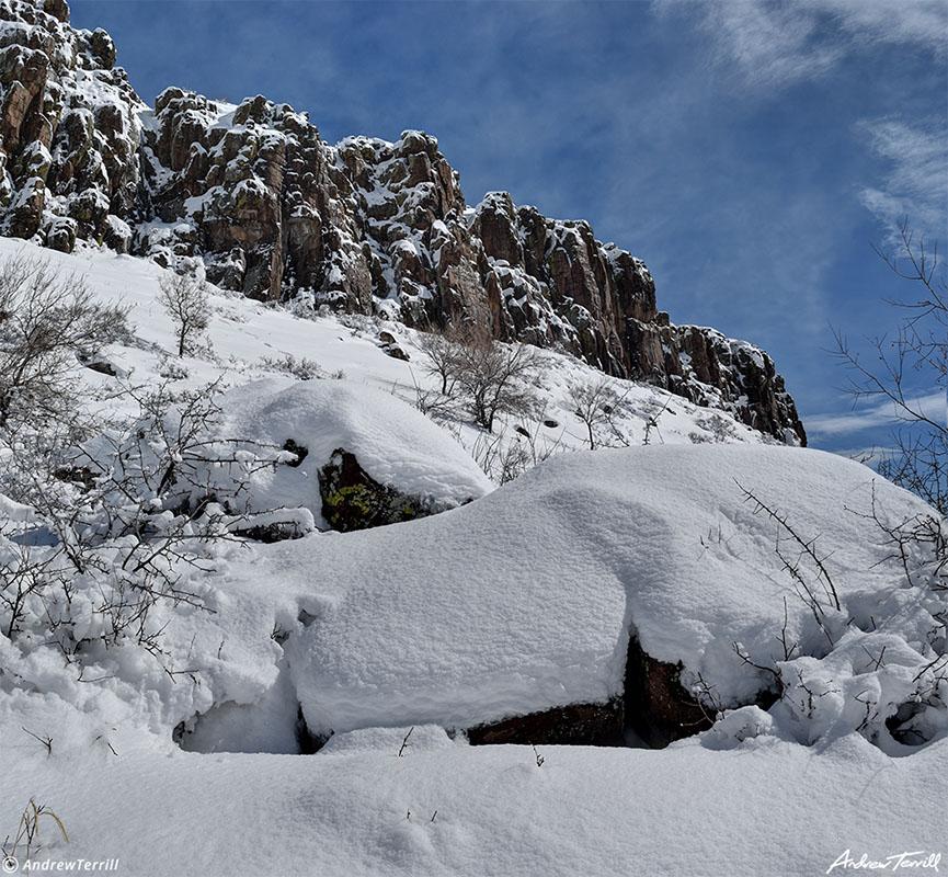 deep snow beneath golden cliffs on north table mountain mesa golden colorado march 2021