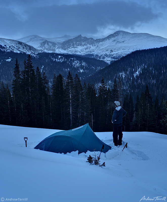 freezing cold winter camp and hiker in mount evans wilderness colorado in evening
