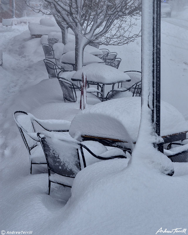 outside cafe restaurant chairs and tables in deep snow golden colorado march 2021