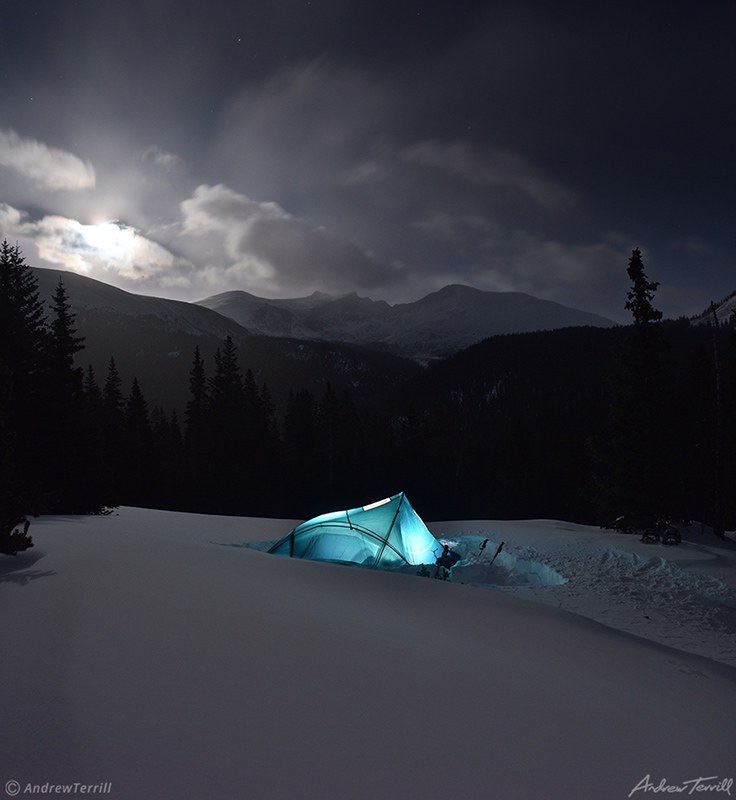 tent glowing at night during winter camp in snow in colorado near mount evans wilderness