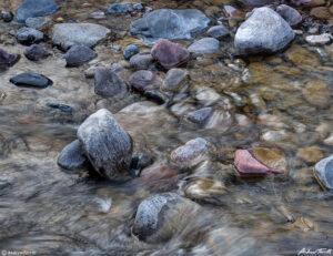 colorful granite rocks in mountain river colorado