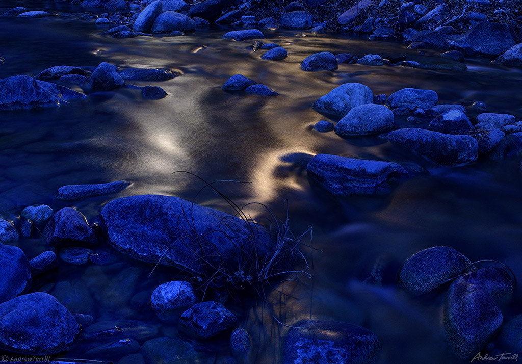 light reflection on mountain stream by night