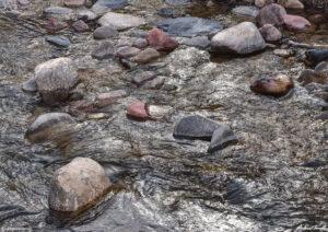mountain creek and rocks in colorado silver light