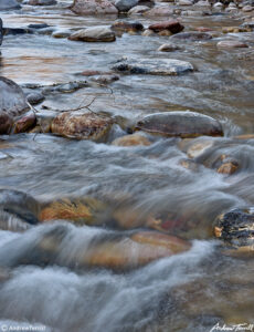 mountain river running peacefully blurred water