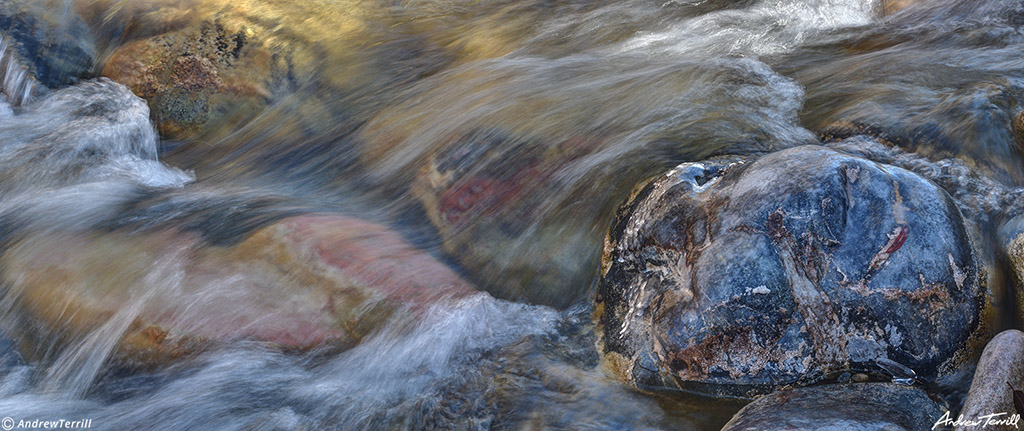 water in motion rushing in mountain river passed glistening rock