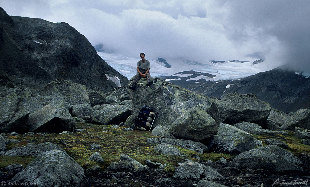 andrew terrill sitting on rocks in narvik fjells and mountains arctic norway with glaciers