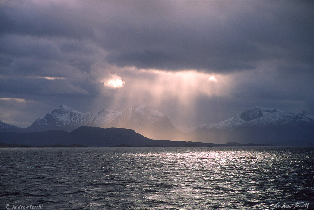 sunbeams across a fjord in arctic norway rays of light