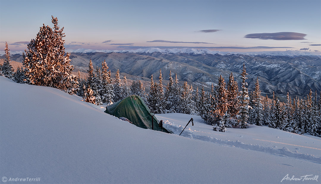winter sunrise with alpenglow on frosted tent wild camping in colorado