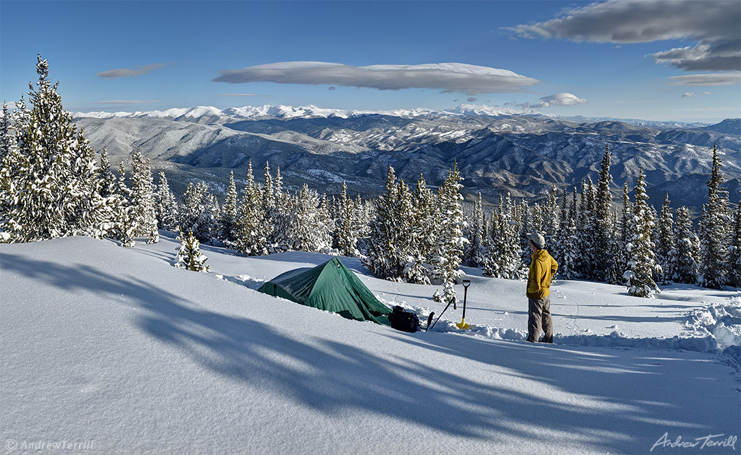 Winter camping in snow colorado rocky mountains staring at view