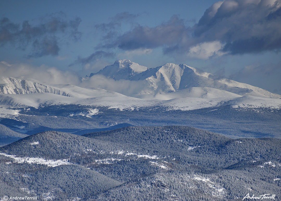 clearing storm clouds Longs Peak Rocky Mountain National Park winter snow