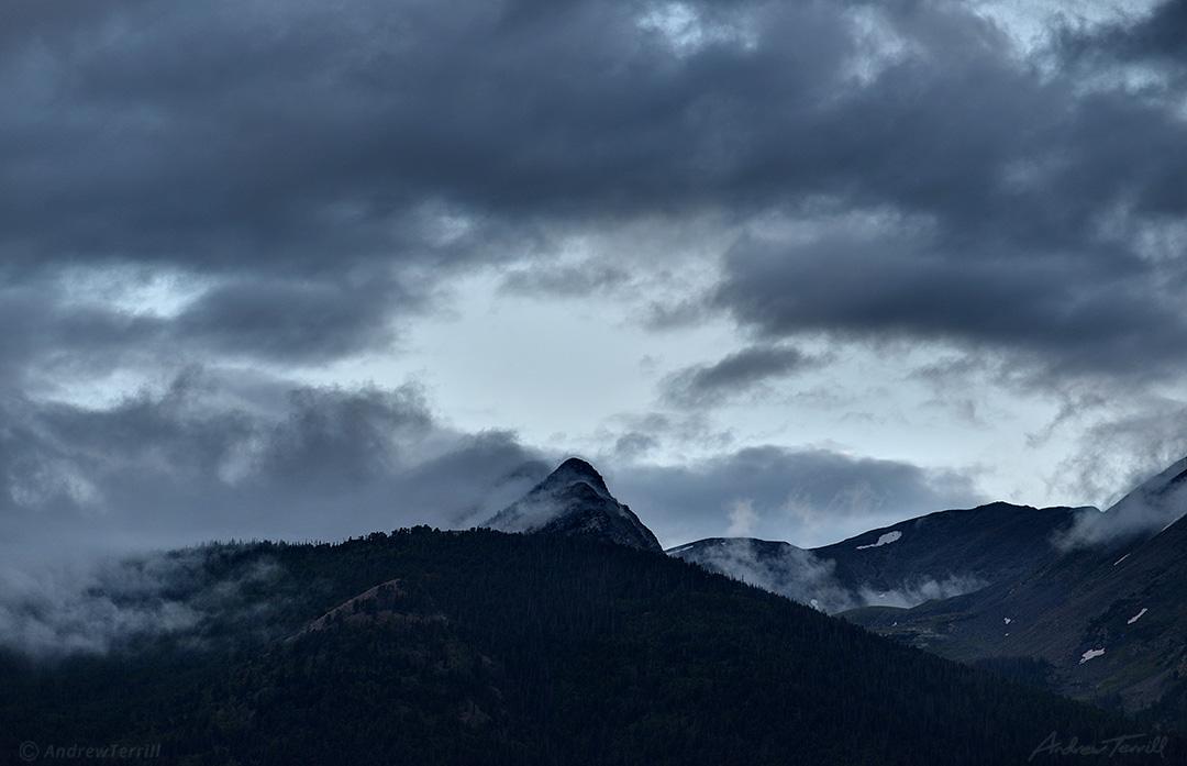 dispersing clouds evening colorado rocky mountains