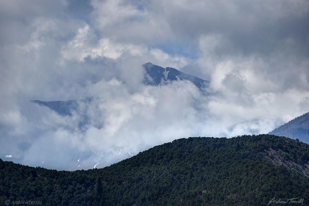 mountain appearing through clouds sangre di cristo range colorado