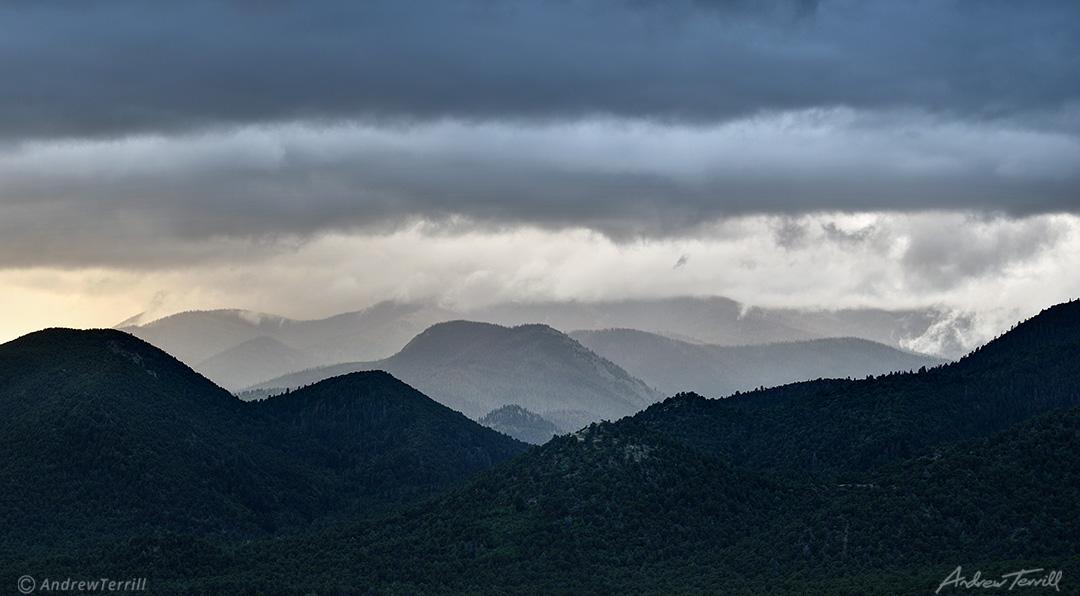 rain clouds over forests beneath the sangre di cristo range