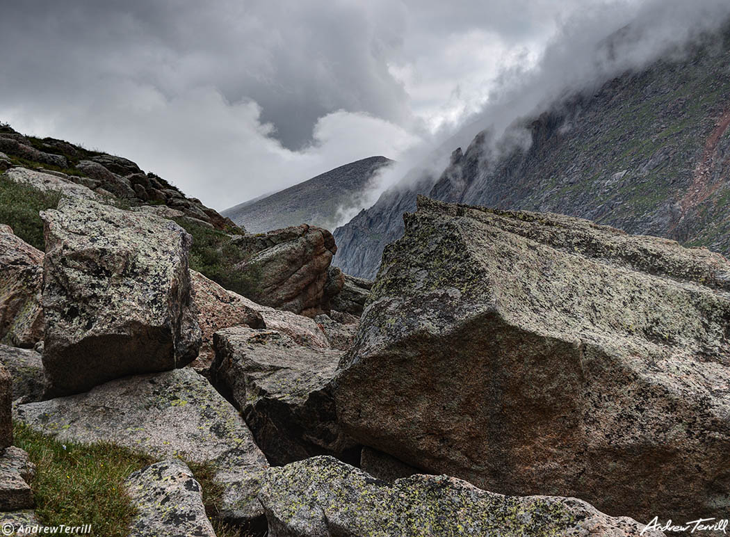 boulders mountains and storm clouds colorado