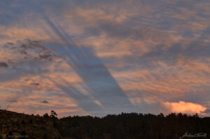 Crepuscular Rays and shadow bands at sunset in colorado