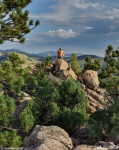 andrew terrill sitting on rock colorado foothills august 2021