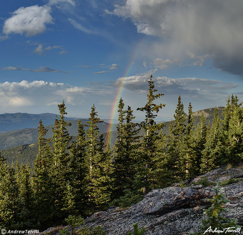 rainbow over colorado foothills and forests august
