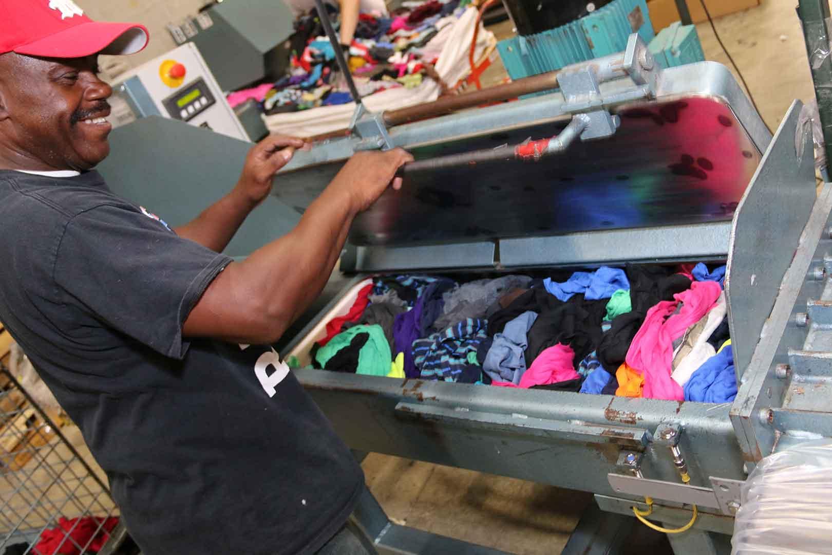 man prepares rags for packaging