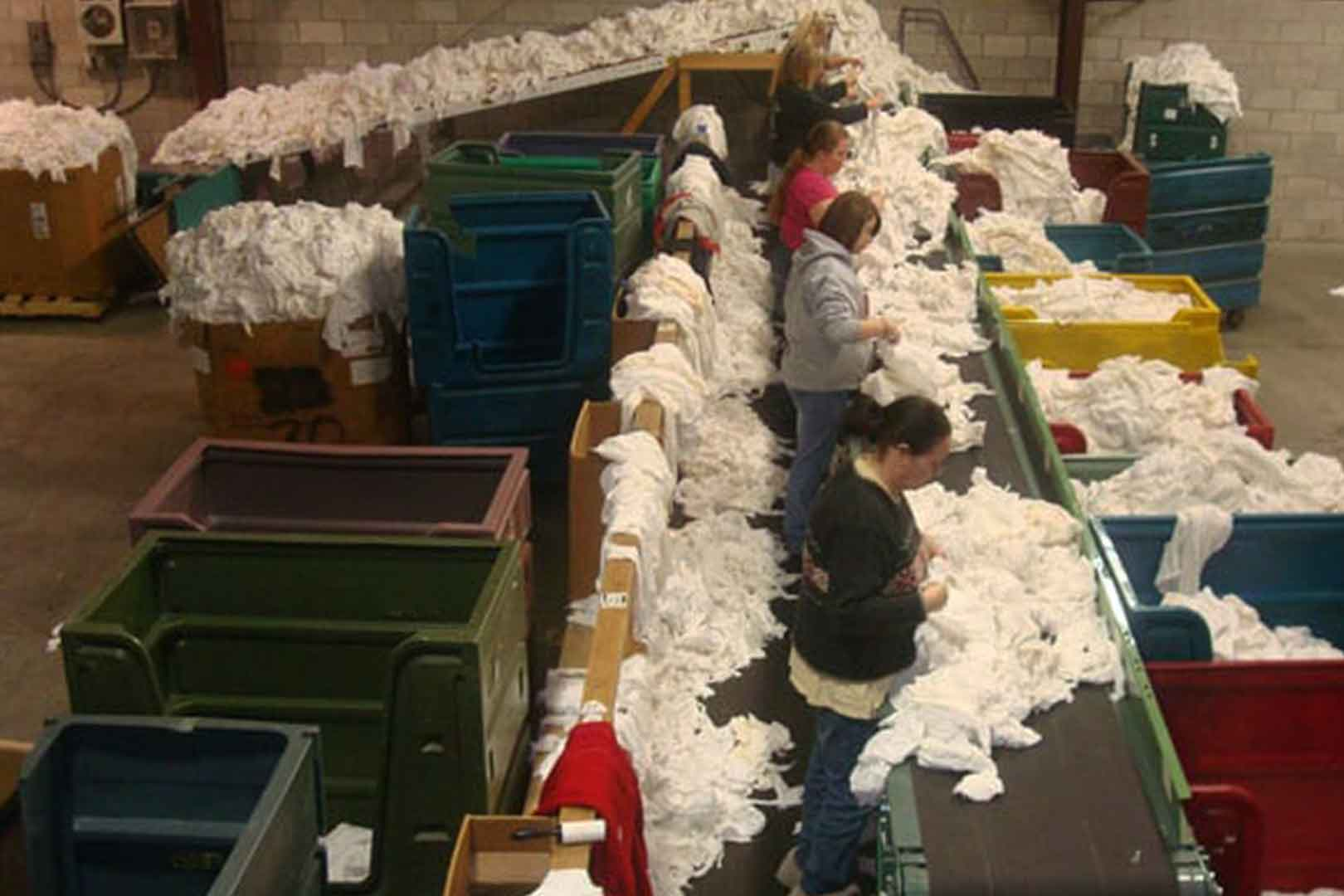 assembly line distributing white rags