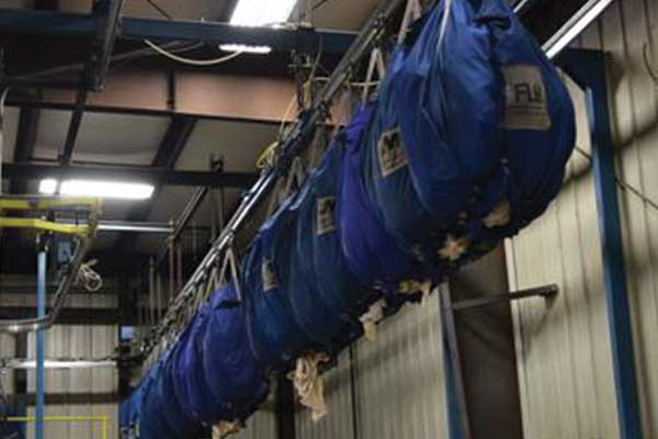 laundry bags hanging from rail system