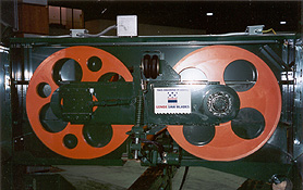 """General Assembly of 36"""" x 1-1/2"""" Face (for 2"""" blade) Horizontal Bandmill. Both 36"""" dia. bandwheels are made from steel, are stress relieved, fully machined, crowned, high speed dynamically balanced for vibration free use and painted safety orange. Wheels are generally sold in matched pairs with the driver being heavier than the idler (keeping the external inertia of the wheels in proportion)"""