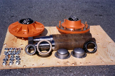"""Heavy Duty Hub Assemblies. 20,000 Lb. capacity, oil or grease lubricated. 4 1/2"""" Dia. Spindle, can be modified to suit your particular requirements or supplied as shown. The spindle is made of high strength material"""