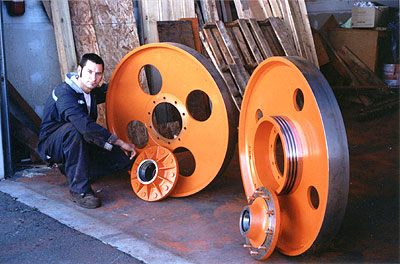 """Pair of 44"""" Dia. x 4 3/8"""" Face Bandwheels. Driver Wheel has 20"""" Dia. Sheave machined with the wheel. 20,000 Lb. Hub Assemblies shipped with the wheels. Idler and Driver have approximately 20% weight difference to improve cutting performance"""