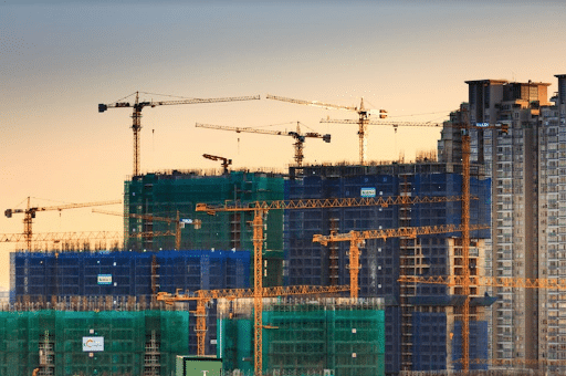 Cranes at dusk to show commercial real estate development