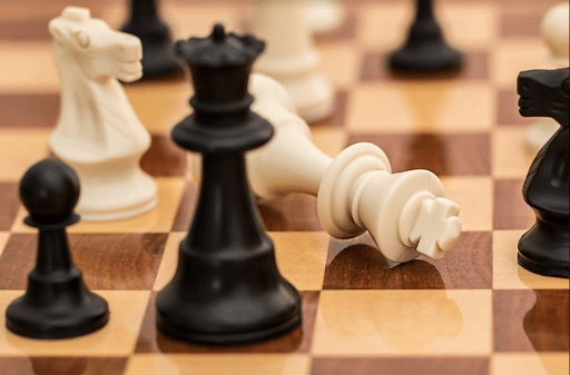 Chess pieces on a chessboard to demonstrate strategy
