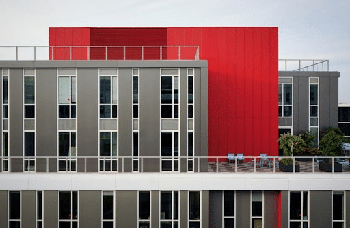 Contemporary commercial real estate building with grey and red walls