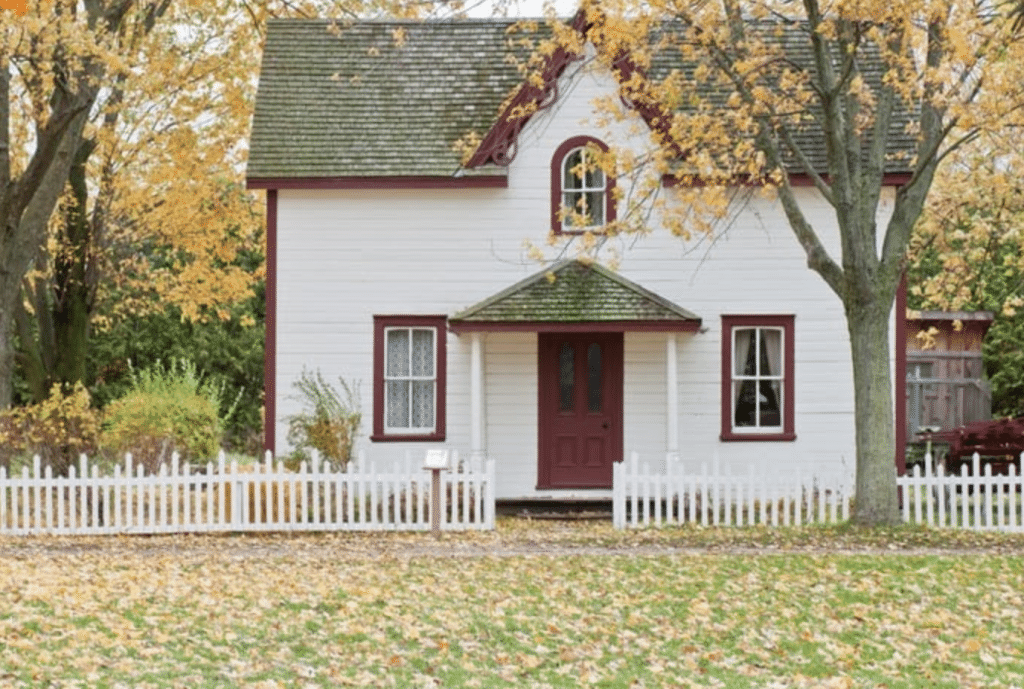 Residential real estate property with white walls and red trimming