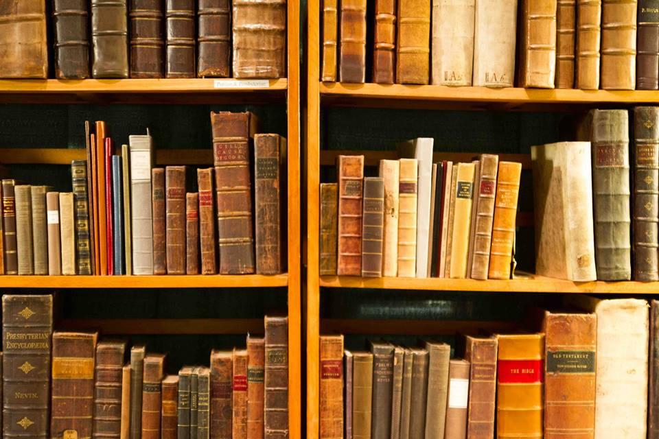 Antique books on a shelf