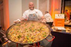 chef with big pan of paella