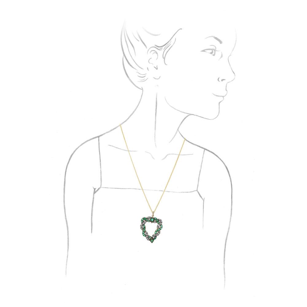 An Emerald and Diamond Heart Pendant