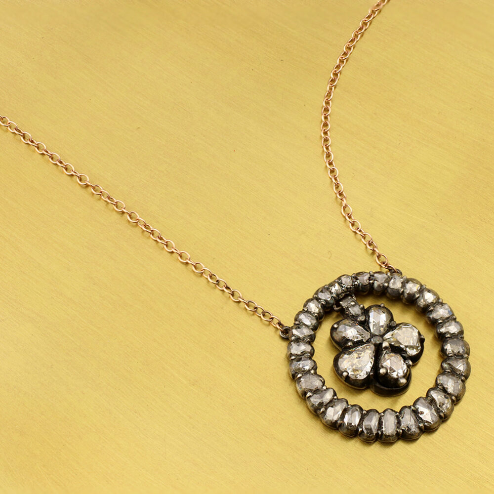 An Antique Diamond and Silver Pendant Necklace