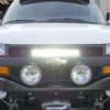 Front Of Chevy Express Van showing stealth series LED Bar brackets for behind grill with light on