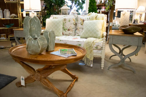 floral sofa with wooden accents