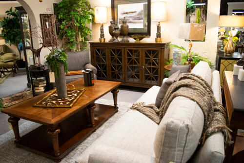 wooden accent cabinet and grey sofa