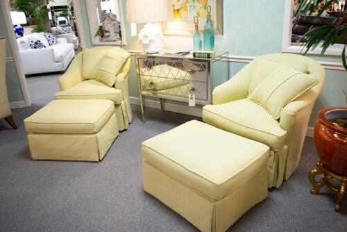 bright yellow accent chairs with ottomans and mirrored accent cabinet