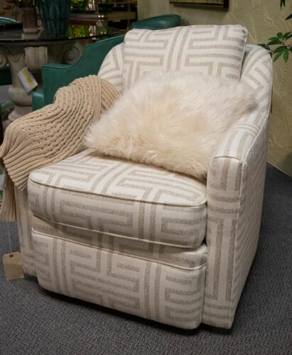 white and silver patterned accent chair