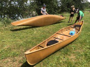 Wenonah Itasca Canoe next to Champlain Canoe