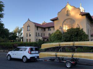 Malone MicroSport Kayak Canoe Trailer behind White Kia Soul Portland Oregon