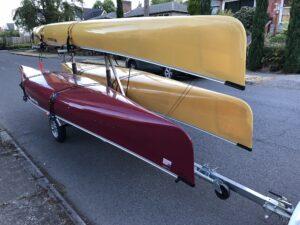 MicroSport Canoe Trailer with three canoes Wenonah Champlain and Seneca