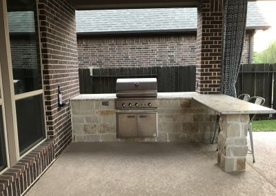 Backyard grill by the pool