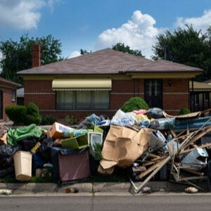Homeowners belonging piled out on the curb after the eviction process